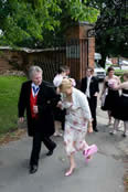 Essex wedding toastmaster Richard Palmer assisting wedding guests into church