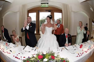 English Toastmaster announces the bride and bridegroom into their wedding breakfast